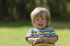 France, Britanny, Sainte-Anne-la-Palud, portrait of smiling little boy Stock Photos