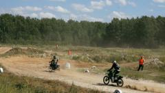 Powerful motorcyclyes on challenging dirt track. Stock Footage
