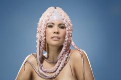 Stock Photo of Portrait of woman wearing octopus headdress