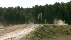 Motorcyclists in a bright outfit jumping Stock Footage