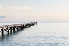 Spain, Balearic Islands, Majorca, one person standing on a jetty in the morning - stock photo