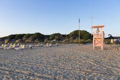 Spain, Balearic Islands, Majorca, one teenage boy standing on a lifeguard stand - stock photo