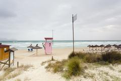 Spain, Balearic Islands, Majorca, one teenage boy climbing on a lifeguard stand - stock photo