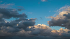 Storm clouds against the blue sky in the evening  Stock Footage