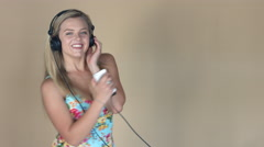 Blonde girl rocking out with her cellphone 4K Stock Footage