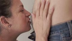 Woman Kisses Belly of a Man Stock Footage