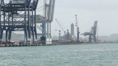 Comercial container ship docks piers cranes Stock Footage