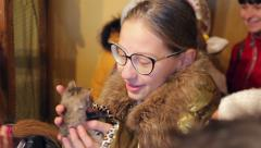 Animal shelter, girl caressing a kitten - stock footage