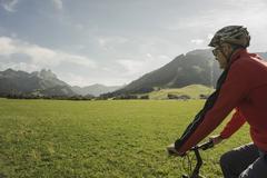Austria, Tyrol, Tannheimer Tal, man driving mountainbike - stock photo