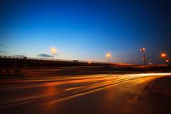 beautiful blue dusky sky peak of twilight time and light painting on asphalt  - stock photo