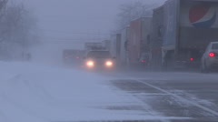 Blizzard and high wind in severe snow storm trucks stranded Stock Footage