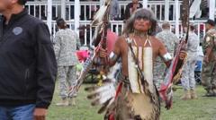 Pow wow dancer with dead eagle's head Stock Footage