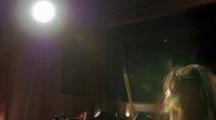 Girl playing violin in spotlight - stock footage