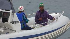 Boats follow marathon swimmer to Toronto across lake Ontario Stock Footage