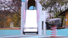 seesaw Kids playground  in Autumn Fall time - stock footage