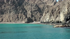 Muscat / Maskat Arabia Orient Oman sultanate 117 rocky bay from seaside Stock Footage