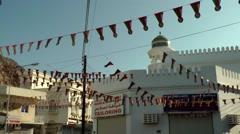 Arabia Orient Oman sultanate city of Muttrah (Matrah) 132 pennants above street - stock footage