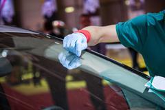 Repair car windshield Stock Photos