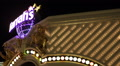 Harrah Hotel Casino Neon Sign Bulb Lights Entrance Iconic Las Vegas Nightlife US HD Footage