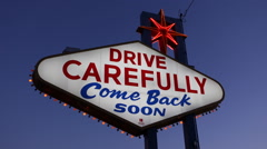 Drive Carefully Come Back Soon Las Vegas Neon Sign Illuminated Night Lights Dusk Stock Footage