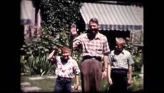 Father and 2 sons wave at camera (vintage 8mm home movie) Stock Footage