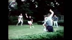Stock Video Footage of Playing football in the yard (vintage 8mm home movies)
