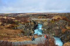 Hraunfossar lava waterfalls falling with blue water Stock Photos