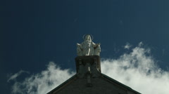 Maria figure on church, dramatic sky Stock Footage