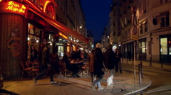 Bar in Paris on street corner at night Stock Footage
