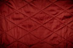 Red quilted material texture Stock Photos
