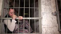 Depressed prisoner longing for freedom Stock Footage