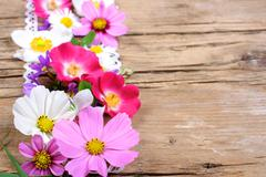Table decoration with cosmos, roses and other flowers Stock Photos