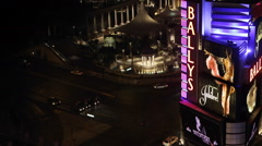 Ballys Neon Signs Las Vegas Busy Intersection Cars Passing Night Evening Lights Stock Footage