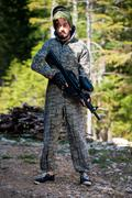Paintball player posing for camera - stock photo