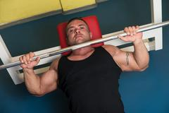 Weightlifter On Benchpress - stock photo