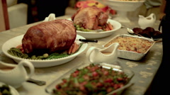 Thanksgiving Table with Family Passing Around Plates Stock Footage