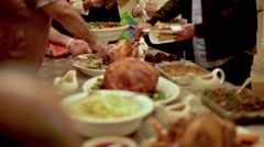 Thanksgiving Table with Turkey, Ham, and Side Dishes on Beautiful Display - stock footage