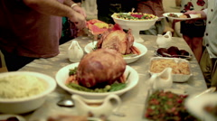 Stock Video Footage of Thanksgiving Table Dishes and Side Dishes Man Carving Slicing Serving Turkey