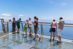 Tourists visiting  the cliffs of gabo girao at madeira island Stock Photos