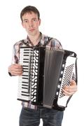 man playing an accordion isolated over white - stock photo