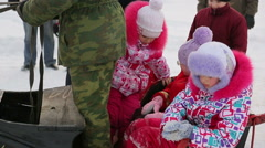 Children sit in a sleigh and depart Arkistovideo