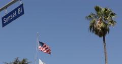LA Establishing Shot Sunset Boulevard Street Road Sign Los Angeles American Flag - stock footage