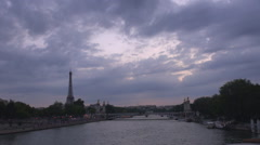 Eiffel tower traffic street Alexander Bridge Seine river twilight Paris city day Stock Footage