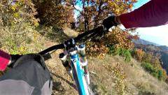 Extreme mountain bike race. view from handlebars of man on bike on dirt track Stock Footage