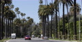 Establishing Shot Spectacular View Beverly Hills Drive Cars Passing Los Angeles Footage