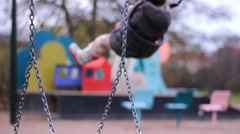 Chain swing,out of focus girl on swing kids playground sand toys Stock Footage