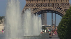 Happy kids play fountain water Eiffel Tower Paris cityscape summer day iconic  - stock footage