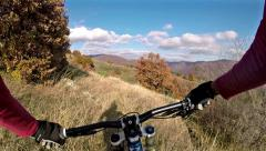 Extreme sport race downhill. cyclist riding mountain bike in the woods pov Stock Footage