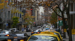 City street with traffic and yellow cab in Seattle Stock Footage