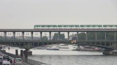 Aerial view Paris public transportation car pass metro train Seine River city  Stock Footage